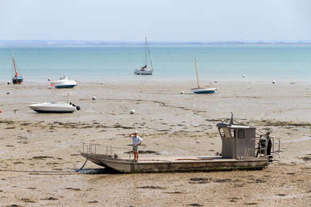 Boats on dry land at the beach at low tide in Cancale, Brittany, France, where tidal differences are extremely big