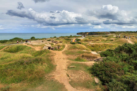 Beautiful view of the remains of German bunkers at the Pointe du Hoc in the dunes of Normandy, France, a WW2 memorial site Stock Photo