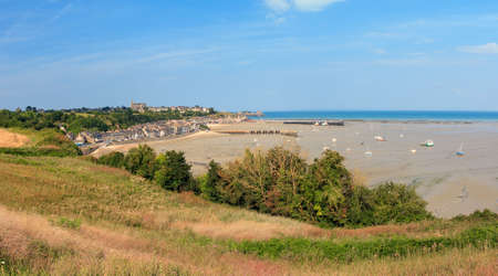 Beautiful cityscape view of the skyline and beach at low tide of the city Cancale, France, in summer