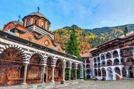 Beautiful view of the Orthodox Rila Monastery, a famous tourist attraction and cultural heritage monument in the Rila Nature Park mountains in Bulgaria Imagens