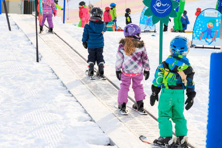 Group of young children is having skiing lessons for the first time in the Alps in the Brandnertal, Vorarlberg Austria, on January 19, 2015