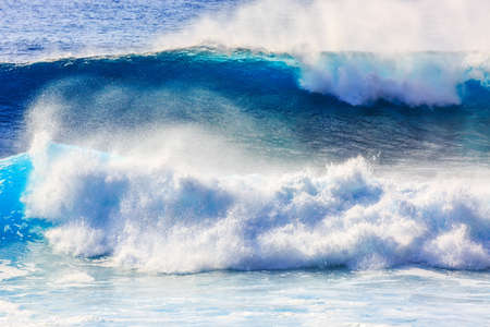 Beautiful seascape view of the big blue surf waves of the Atlantic ocean on the island Madeira, a popular surfing tourist destination