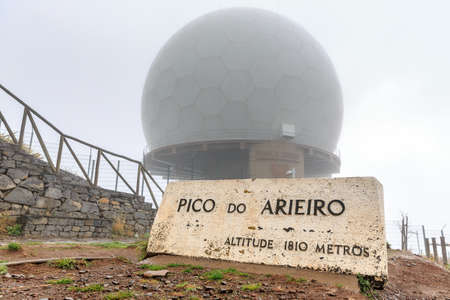 Beautiful misty morning view of the top of the Pico do Arieiro in the mountains of Madeira on a cloudy summer day
