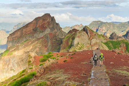 Beautiful panorama view of the footpath trail in the mountains of Madeira at Pico do Areeiro (Arieiro) while hiking to Pico Ruivo on a cloudy summer day Stock Photo