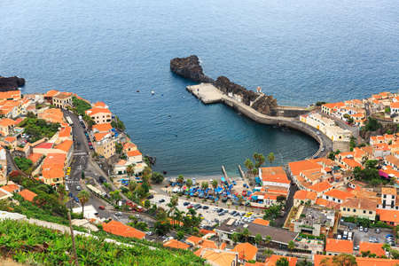 Beautiful view of the vibrant fisherman town Camara de Lobos on the island of Madeira in summer Imagens