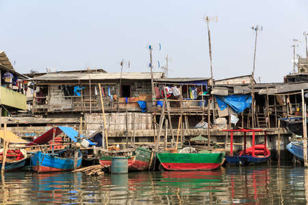 Beautiful view of generic homes at the waterfront in the old Sunda Kelapa harbor area in Jakarta, Indonesia Stock Photo