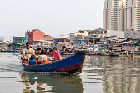 Locals commute in the old Sunda Kelapa harbor area by boat in Jakarta, Indonesia, on August 2, 2015