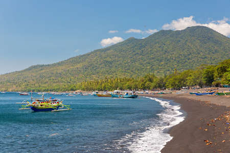 Beautiful view of a beach on the island of North Sulawesi, Indonesia, with fishing boats and vibrant blue sea