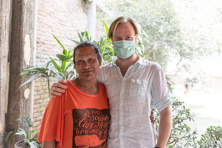 Beautiful portrait of a Caucasian tourist with a transgender local in Sumatra, Indonesia, on August 7, 2015