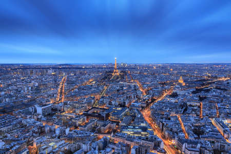 Beautiful aerial skyline cityscape of Paris, France, after sunset in the blue hour, with the Eiffel tower, seen from the Montparnasse skyscraper