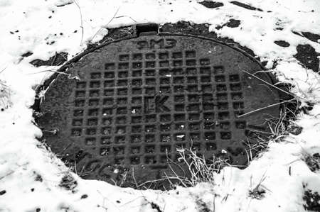 manhole cover: manhole cover, well Stock Photo