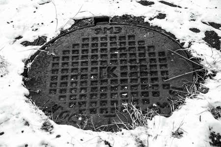 manhole cover: manhole cover, well Stock Photo