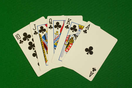 poker, royal flush, cards on green cloth, felt Editorial