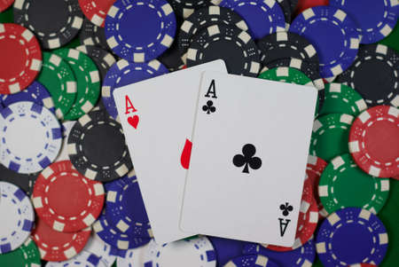 poker, hand - pocket aces on colorful chips