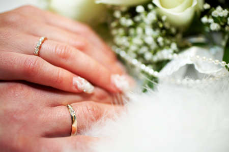 hands of groom and bride with golden wedding rings Stock Photo