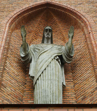 statue of Jesus on facade of Holy Virgin Mary Scapular Church in Druskininkai, Lithuania. The first brick church in Druskininkai was completed in the 1844. Stock Photo