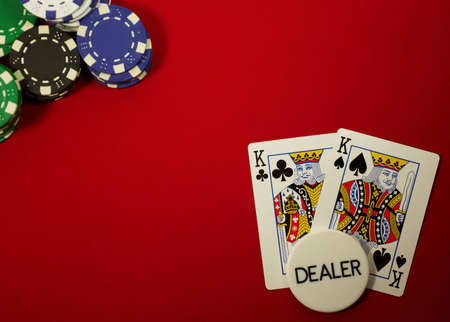 poker hand, pocket kings on the button, on red felt