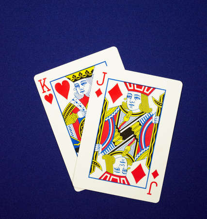 playing cards king jack (in poker that hand names King James) on blue cloth