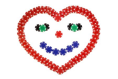 creative poker chips, smiling heart made of red blue black and white poker chips isolated over white Stock Photo
