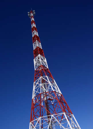 high repeater tower on blue sky background