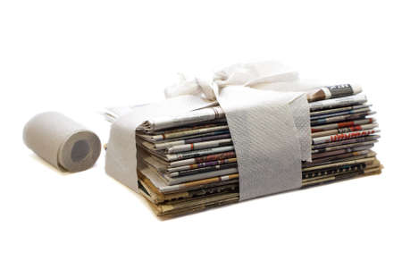 libel: stack of newspapers wrapped in toilet paper concept