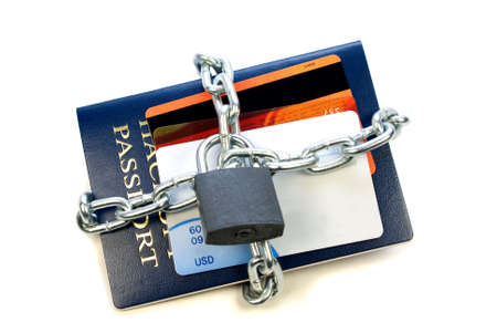 personal information protection concept, passport and credit debit cards chained isolated over white