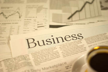 heading newspaper, business pages with a cup of coffee
