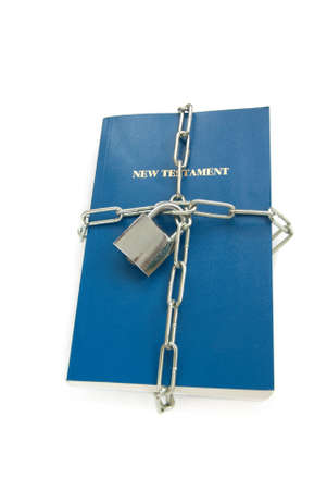 new testament chained isolated over white, escape religious freedom concept Stock Photo - 6372005
