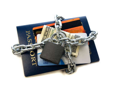 personal information protection concept, passpor, one hundred dollar t and credit debit cards chained isolated over white Stock Photo