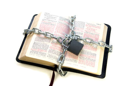open bible chained isolated over white background