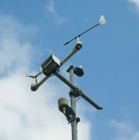 meteorology measuring equipment over blue cloudy sky