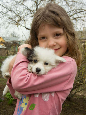 portrait of beautiful girl with a nice little puppy Stock Photo