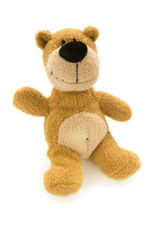 brown teddy bear sitting with raised hand isolated over white