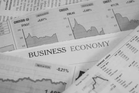 newspapers, business and economy page, yellow and white colors photo