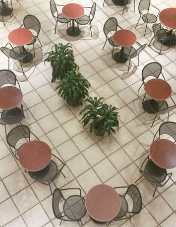Empty chairs in fastfood restaurant concept, top view. Stock Photo
