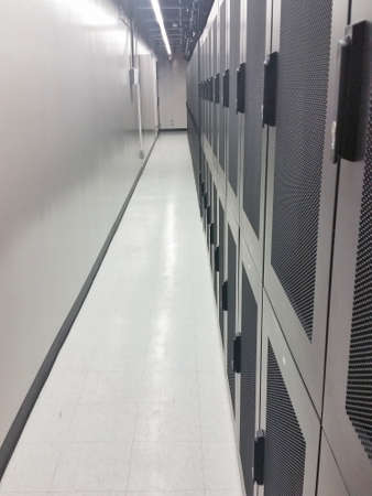 colocation: Data center shared cabinets and corridor view.