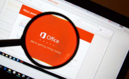 microsoft: MONTREAL, CANADA - FEBRUARY, 2016 - Microsoft Office 365 installation process on a laptop under magnifying glass. Editorial