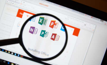 microsoft: MONTREAL, CANADA - FEBRUARY, 2016 - Microsoft Office 365 software installation on a laptop under magnifying glass.