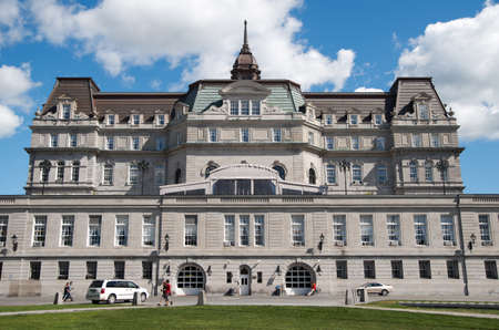 replaced: MONTREAL, CANADA - AUGUST, 2015 -Montreal Old City Hall.  The green roof is replaced with a new bronze roof after restoration.