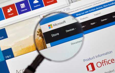 microsoft: MONTREAL, CANADA - FEBRUARY, 2016 - Microsoft store on the web under magnifying glass. Editorial