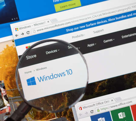 MONTREAL, CANADA - FEBRUARY, 2016 - Microsoft Windows on the web under magnifying glass. Editorial