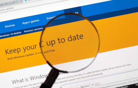 msn: MONTREAL, CANADA - FEBRUARY, 2016 - Microsoft Update on the web under magnifying glass.
