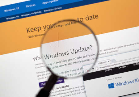 microsoft: MONTREAL, CANADA - FEBRUARY, 2016 - Microsoft Update on the web under magnifying glass.