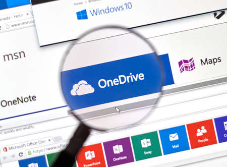 microsoft: MONTREAL, CANADA - FEBRUARY, 2016 - Microsoft One Drive on the web under magnifying glass. Editorial