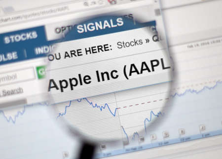 ticker: MONTREAL, CANADA - FEBRUARY, 2016 - AAPL - Apple Inc stock ticker with charts under magnifying glass.