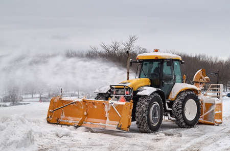 tree removal service: MONTREAL, CANADA - FEBRUARY, 2016 - Snowblower track cleaning a road near Montr Royal park, Montreal. Editorial