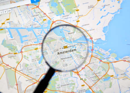 MONTREAL, CANADA - FEBRUARY, 2016 - Amsterdam on Google Maps app under magnifying glass.