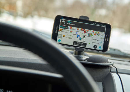 MONTREAL, CANADA - MARCH 3, 2016 - GPS application Waze running on Samsung S5 in a car. Waze is one of the most popular GPS applications.