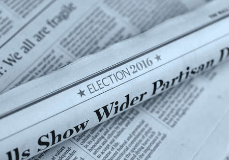 scheduled: MONTREAL, CANADA - MARCH 3, 2016 - Rolled newspaper with Election 2016 article. The United States presidential election of 2016, scheduled for Tuesday, November 8, 2016.