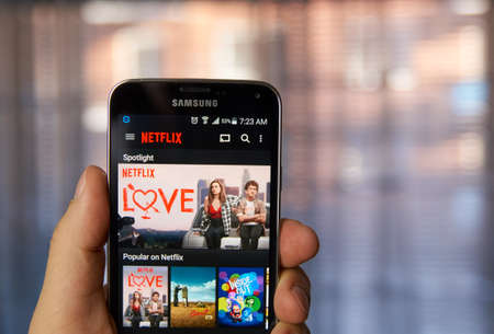 samsung: MONTREAL, CANADA - MARCH 4, 2016 - Netflix application running on android Samsung S5. Netflix is one of the most popular global provider of streaming movies. Editorial